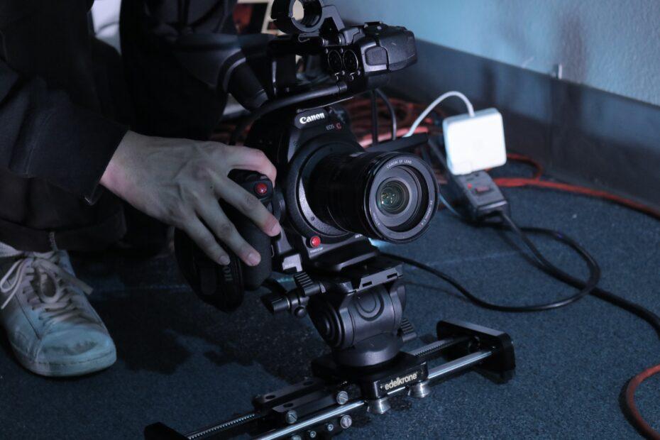 black sony dslr camera on black table
